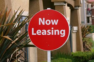 'Now Leasing' sign in a residential apartment complex